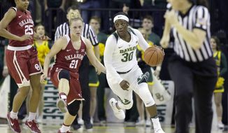 Baylor guard Alexis Jones (30) dribbles after the steal against Oklahoma guards Gabbi Ortiz (21) and Gioya Carter (25) during the second half of an NCAA college basketball game against Oklahoma, Sunday, Jan. 29, 2017, in Waco, Texas. Baylor won 92-58. (AP Photo/LM Otero)