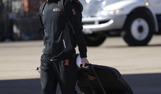 Atlanta Falcons' Matt Ryan walks to the bus as the team arrive at George Bush Intercontinental Airport for the NFL Super Bowl 51 football game against the New England Patriots Sunday, Jan. 29, 2017, in Houston. (AP Photo/David J. Phillip)