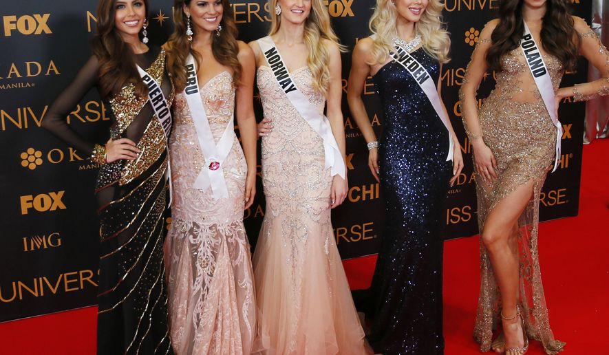 Miss Universe contestants pose on the red carpet on the eve of their coronation Sunday, Jan. 29, 2017, at the Mall of Asia in suburban Pasay city south of Manila, Philippines. Eighty-six conestants are vying for the title to succeed Pia Wurtzbach from the Philippines. From left, Brenda Jimenez of Puerto Rico, Valeria Piazza of Peru, Christina Waage of Norway, Ida Ovmar of Sweden, Isabella Krzan of Poland.(AP Photo/Bullit Marquez)