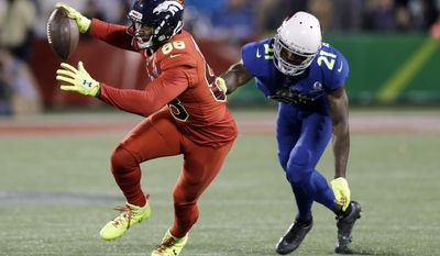 NFC strong safety Landon Collins (21), of the New York Giants, attempts to stop AFC wide receiver Demaryius Thomas (88), of the Denver Broncos, during the first half of the NFL Pro Bowl football game Sunday, Jan. 29, 2017, in Orlando, Fla. (AP Photo/Chris O'Meara)