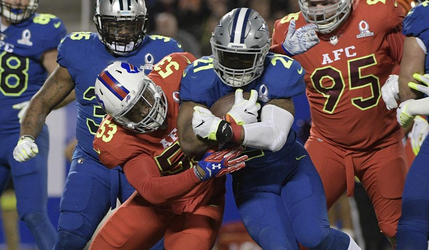 NFC strong safety Landon Collins (21), of the New York Giants is tackled by AFC linebacker Zach Brown (53), of the Buffalo Bills, during the first half of the NFL Pro Bowl football game Sunday, Jan. 29, 2017, in Orlando, Fla. (AP Photo/Phelan M Ebenhack)