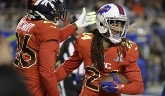 AFC strong safety Darian Stewart (26), of the Denver Broncos, congratulates cornerback Stephon Gilmore (24), of the Buffalo Bills, after Gilmore intercepted a pass in the end zone, during the first half of the NFL Pro Bowl football game Sunday, Jan. 29, 2017, in Orlando, Fla. (AP Photo/Chris O?Meara)