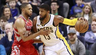 Houston Rockets guard Eric Gordon, left, defends against Indiana Pacers forward Paul George in the first half of an NBA basketball game, Sunday, Jan. 29, 2017, in Indianapolis. (AP Photo/R Brent Smith)