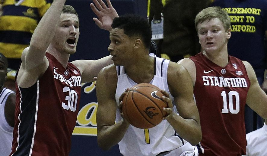 California's Ivan Rabb, center, looks to pass away from Stanford's Grant Verhoeven (30) and Michael Humphrey (10) in the first half of an NCAA college basketball game Sunday, Jan. 29, 2017, in Berkeley, Calif. (AP Photo/Ben Margot)