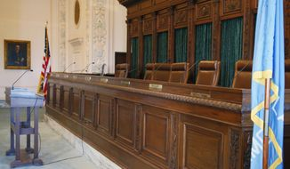 This Wednesday, Jan. 25, 2017 photo, shows the Supreme Court bench in Oklahoma City. The seat at far right has been vacated by former Supreme Court Judge Steven Taylor. Two district judges who focus on the daily administration of justice in Oklahoma and the state's solicitor general and chief litigator on a variety of high-profile issues are vying to be Gov. Mary Fallin's first appointment to the Oklahoma Supreme Court. The candidates are Bryan County District Judge Mark Campbell, LeFlore County District Judge Jonathan Sullivan and Solicitor General Patrick Wyrick, a native of Atoka. (AP Photo/Sue Ogrocki)