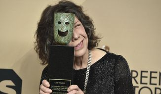 Lily Tomlin poses in the press room with the Lifetime Achievement Award at the 23rd annual Screen Actors Guild Awards at the Shrine Auditorium & Expo Hall on Sunday, Jan. 29, 2017, in Los Angeles. (Photo by Jordan Strauss/Invision/AP)