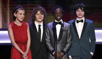 Millie Bobby Brown, from left, Gaten Matarazzo, Caleb McLaughlin, and Finn Wolfhard present the award for outstanding performance by an ensemble in a comedy series at the 23rd annual Screen Actors Guild Awards at the Shrine Auditorium & Expo Hall on Sunday, Jan. 29, 2017, in Los Angeles. (Photo by Chris Pizzello/Invision/AP)