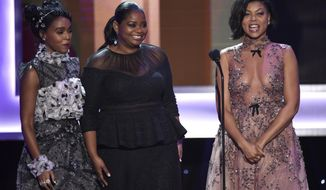 Janelle Monae, from left, Octavia Spencer, and Taraji P. Henson speak at the 23rd annual Screen Actors Guild Awards at the Shrine Auditorium & Expo Hall on Sunday, Jan. 29, 2017, in Los Angeles. (Photo by Chris Pizzello/Invision/AP)