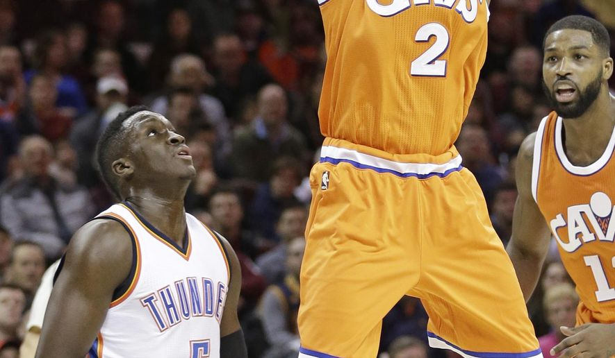 Cleveland Cavaliers' Kyrie Irving (2) shoots against Oklahoma City Thunder' Victor Oladipo (5) in the first half of an NBA basketball game, Sunday, Jan. 29, 2017, in Cleveland. (AP Photo/Tony Dejak)
