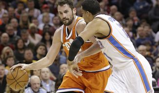 Cleveland Cavaliers' Kevin Love, left, drives against Oklahoma City Thunder' Andre Roberson in the first half of an NBA basketball game, Sunday, Jan. 29, 2017, in Cleveland. (AP Photo/Tony Dejak)