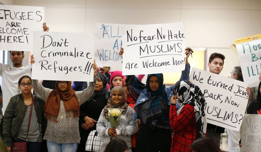 Protesters demonstrate against President Donald Trump's executive order banning Muslims from certain middle eastern countries from entering the United States at the Dallas Forth Worth Airport, Saturday, Jan. 28, 2017, in Dallas. (Brandon Wade/Star-Telegram via AP)