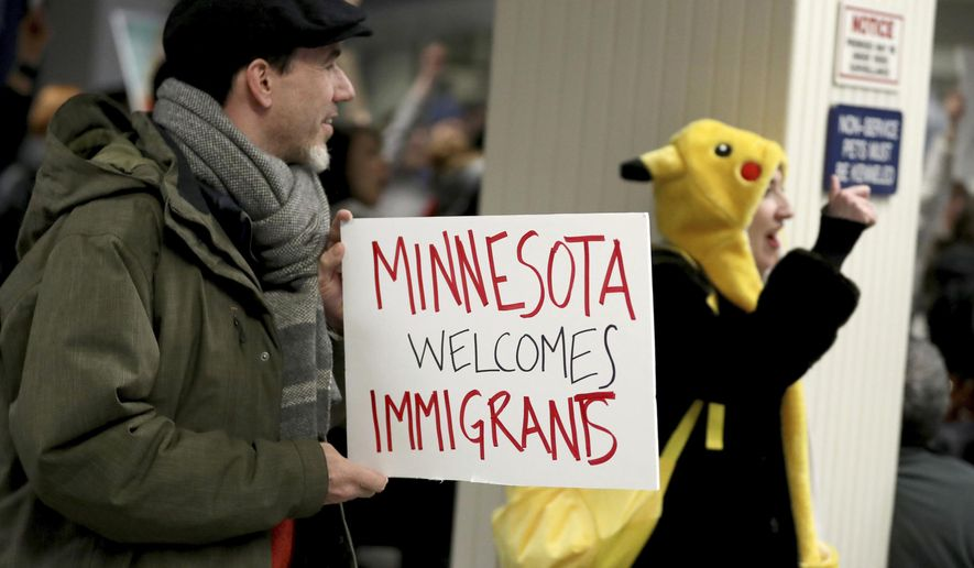 Adrian Hegeman, of St. Paul, holds a sign while joining other opponents to new immigration restrictions to protest an executive order signed by President Donald Trump, restricting immigration from several Muslim nations Saturday, Jan. 28, 2017, at the Minneapolis-St. Paul International Airport, in Minneapolis. (David Joles/Star Tribune via AP)