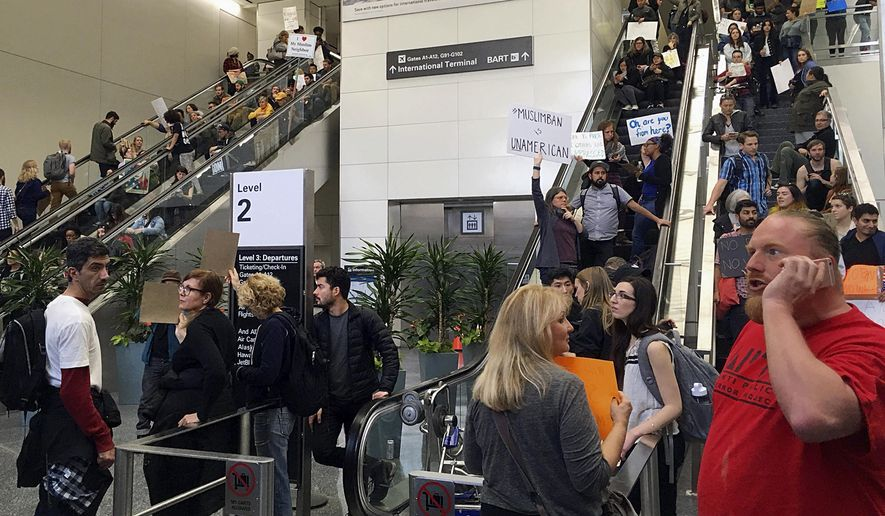 Demonstrators crowd the international terminal as they protest against President Donald Trump's travel ban on refugees and citizens of seven Muslim-majority nations, at San Francisco International Airport on Sunday, Jan. 29, 2017. (AP Photo/Olga Rodriguez)