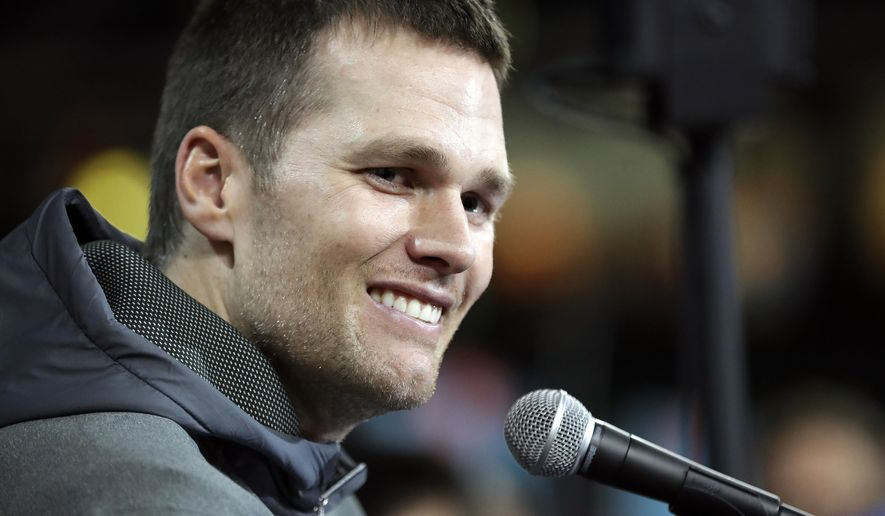 New England Patriots' Tom Brady answers questions during opening night for the NFL Super Bowl 51 football game at Minute Maid Park Monday, Jan. 30, 2017, in Houston. (AP Photo/David J. Phillip)