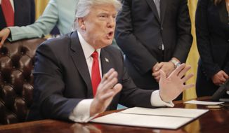"""President Donald Trump speaks in the Oval Office of the White House in Washington, Monday, Jan. 30, 2017, before signing an executive order. Trump order is aimed at significantly cutting regulations. White House officials are calling the directive a """"one in, two out"""" plan. It requires government agencies requesting a new regulations to identify two regulations they will cut from their own departments. (AP Photo/Pablo Martinez Monsivais)"""