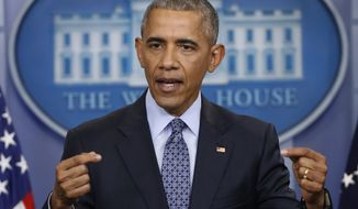 """FILE - In this Jan. 18, 2017 file photo, President Barack Obama speaks during his final presidential news conference, in the briefing room of the White House in Washington. A spokesman for Obama says the former president """"fundamentally disagrees"""" with discrimination that targets people based on their religion. The statement alluded to but did not specifically mention President Donald Trump's temporary ban on refugees from several Muslim-majority countries. (AP Photo/Pablo Martinez Monsivais, File)"""