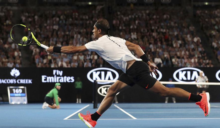 Spain's Rafael Nadal makes a forehand return to Switzerland's Roger Federer in the men's singles final at the Australian Open tennis championships in Melbourne, Australia, Sunday, Jan. 29, 2017. (Scott Barbour/Pool via AP)