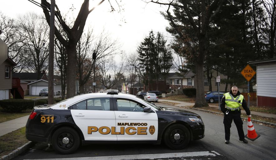 A police officers blocks the entrance to Van Ness Court in Maplewood, N.J., Monday, Jan. 30, 2017, the day after three people were found dead in an apartment there. Police are investigating their deaths as a homicide. (AP Photo/Seth Wenig)