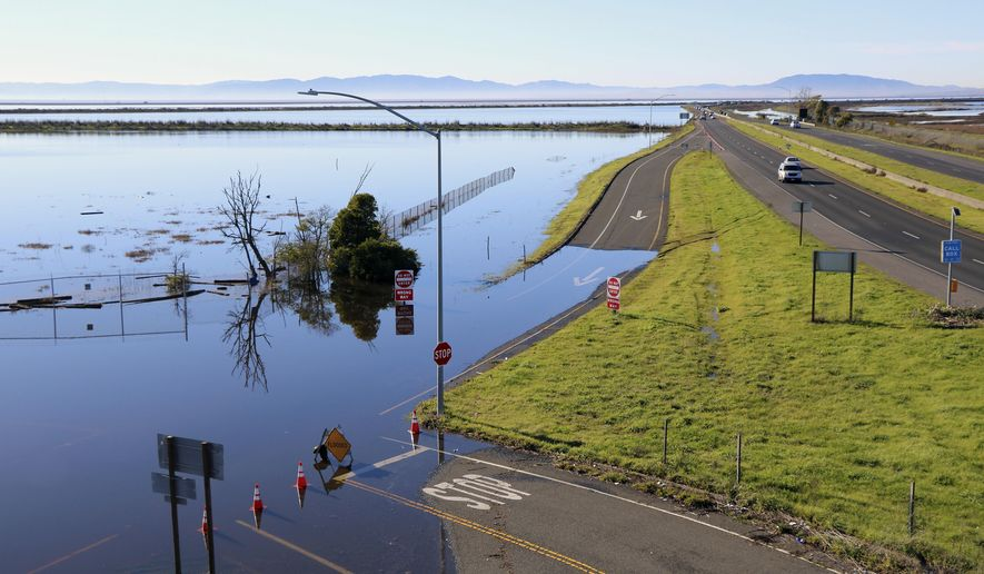 This Jan. 14, 2017 photo provided by Fraser Shilling shows flooding along Highway 37 near Vallejo, Calif.  Ocean rise already is worsening the floods and high tides sweeping California this stormy winter, climate experts say, and this month's damage and deaths highlight that even a state known as a global leader in fighting climate change has yet to tackle some of the hardest work of dealing with it. (Fraser Shilling via AP)
