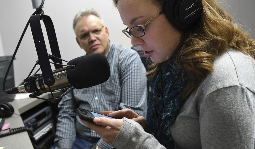 In this January 9, 2017 photo Lacy Scarmana, WVIK producer and co-host of the  'Suspect Convictions' podcast, works with her co-host, Scott Reeder, on recording an advertisement for the podcast at WVIK in Rock Island, Ill. 'Suspect Convictions' revisits the 1990 murder of Jennifer Lewis and the case against Stanley Liggins. In its first week, the podcast ranked in the top five of all U.S. podcasts on iTunes. (Todd Mizener/The Dispatch via AP)