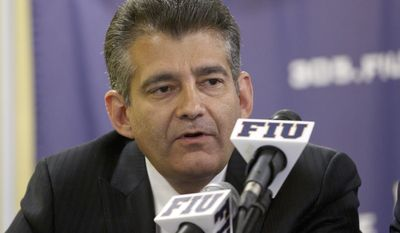 FILE - In this April 16, 2012, file photo, Florida International Vice President Pete Garcia talks to the media during a press conference in Miami, where it was announced that Richard Pitino had been hired to replace Isiah Thomas as head men's basketball coach. FIU football head coach Butch Davis and FIU director of sports and entertainment Garcia have been joined at the hip for much of their football lives, and are again now. Davis' first class of FIU recruits will be unveiled Wednesday, Feb. 1, 2017, and he got plenty of help from Garcia in putting it together, just like at Miami two decades ago when they lured star after star after star to the Hurricanes. (AP Photo/J Pat Carter, File)