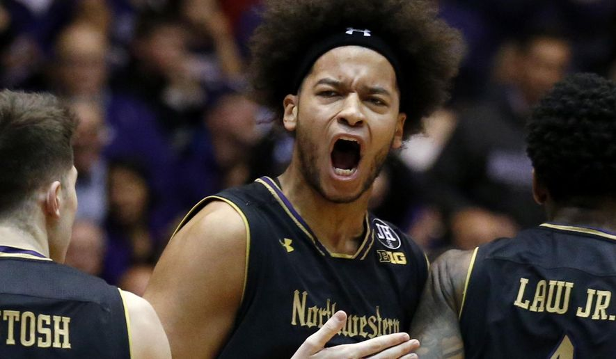 Northwestern center Barret Benson, center, reacts as he celebrates with guard Bryant McIntosh, left, and forward Vic Law after scoring a basket during the first half of an NCAA college basketball game against Indiana, Sunday, Jan. 29, 2017, in Evanston, Ill. Northwestern won 68-55. (AP Photo/Nam Y. Huh)