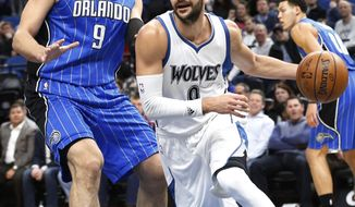Minnesota Timberwolves' Ricky Rubio, right, of Spain, drives around Orlando Magic's Nikola Vucevic of Montenegro during the first quarter of an NBA basketball game, Monday, Jan. 30, 2017, in Minneapolis. (AP Photo/Jim Mone)
