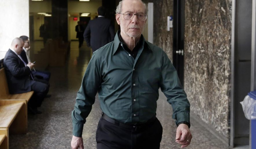 Stan Patz, father of Etan Patz, who went missing in 1979, walks out of state Supreme Court during a break in closing arguments in the retrial of Pedro Hernandez, in New York, Monday, Jan. 30, 2017. The retrial of Hernandez, a man accused of killing 6-year-old Etan Patz in 1979, is ending with lawyers' summations.(AP Photo/Richard Drew)