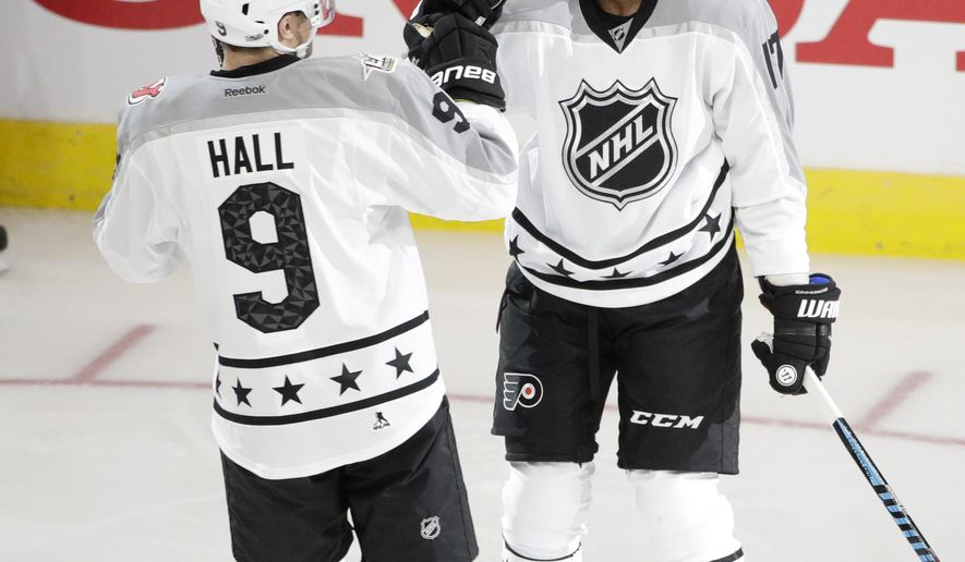 Metropolitan Division's Wayne Simmonds, right, of the Philadelphia Flyers, celebrates his goal with Taylor Hall, of the New Jersey Devils, during the NHL hockey All-Star championship game with the Pacific Division, Sunday, Jan. 29, 2017, in Los Angeles. (AP Photo/Jae C. Hong)