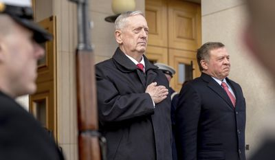 FILE - In this Jan. 30, 2017 file photo, U.S. Defense Secretary Jim Mattis, center, stands with Jordan's King Abdullah II bin Al-Hussein during an honor cordon at the Pentagon. Pyongyang will cast a decidedly dark shadow over U.S. defense secretary's first trip overseas. Mattis is to make his debut with a visit to staunch U.S. allies South Korea and Japan, both of which host tens of thousands of American troops and, for good reason, see North Korea as their biggest national security threat. (AP Photo/Andrew Harnik, File)