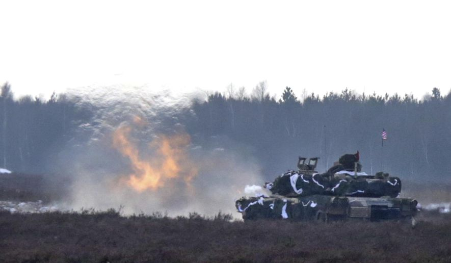 A U.S. Army tank joins the action during their exercise with Polish Army soldiers on training fields in Zagan, Poland, Monday, Jan. 30, 2017. (AP Photo/Krzysztof Zatycki)
