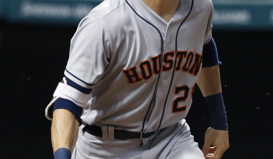 FILE - In this Sept. 7, 2016, file photo, Houston Astros' Colby Rasmus watches his two-run home run off Cleveland Indians starting pitcher Carlos Carrasco during the fourth inning of a baseball game in Cleveland.  Rasmus and the Tampa Bay Rays have finalized a $5 million, one-year contract. Ramus can earn an additional $2 million in performance bonuses, the Rays said Monday, Jan. 20, 2017. (AP Photo/Ron Schwane, File)