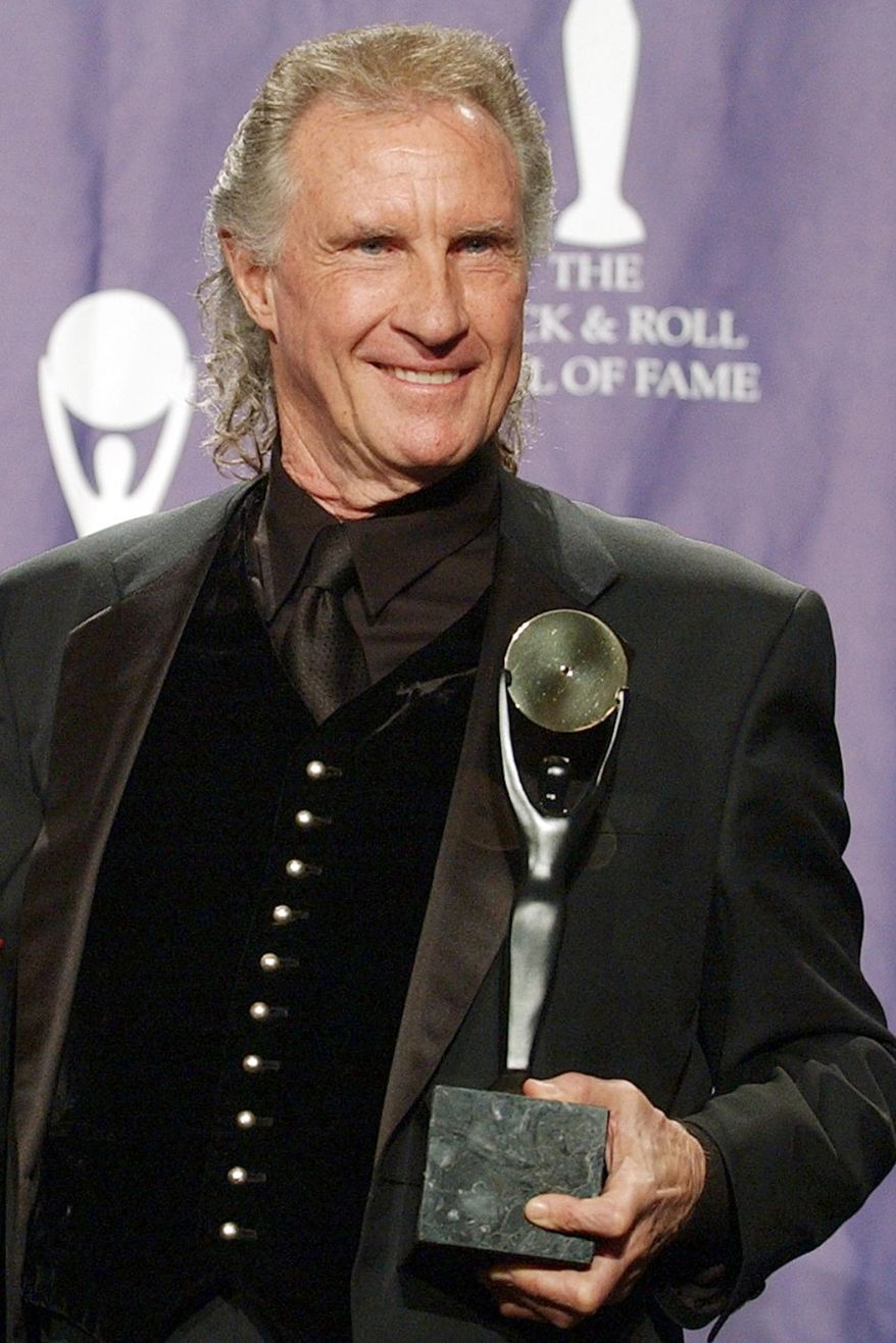 FILE - in this March 10, 2003 file photo, Bill Medley, one half of the famed Righteous Brothers singing duo, poses for photographers after being inducted into the Rock and Roll Hall of Fame in New York. Officials are expected to release additional information on Monday, Jan. 30, about how they solved the 1976 rape and killing of Medley's ex-wife Karen Klaas. Klaas was sexually assaulted and strangled with pantyhose. (AP Photo/Ed Betz, File)