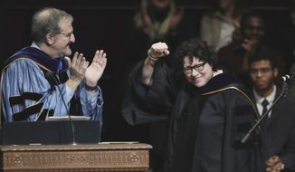 Supreme Court Justice Sonia Sotomayor gestures after receiving a Doctor of Laws degree from University of Michigan President Mark Schlissel, Monday, Jan. 30, 2017, during a ceremony at the university in Ann Arbor, Mich. (AP Photo/Carlos Osorio)