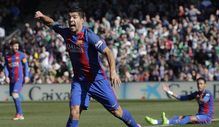 Barcelona's Suarez gestures during La Liga soccer match between Barcelona and Betis at the Benito Villamarin stadium, in Seville, Spain on Sunday, Jan. 29, 2017. (AP Photo/Miguel Morenatti)