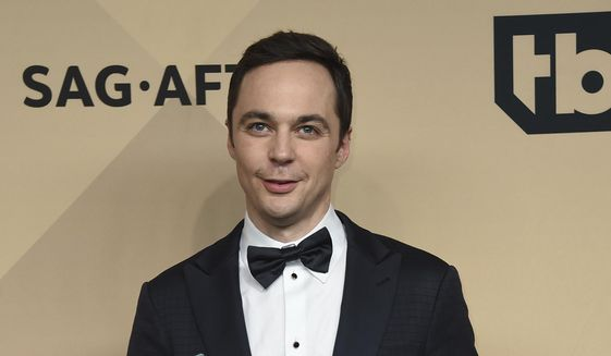 """Jim Parsons poses in the press room with the awards for outstanding performance by a cast in a motion picture for """"Hidden Figures"""" at the 23rd annual Screen Actors Guild Awards at the Shrine Auditorium & Expo Hall on Sunday, Jan. 29, 2017, in Los Angeles. (Photo by Jordan Strauss/Invision/AP)"""