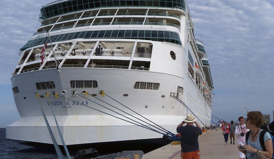In this Feb. 11, 2016 photo provided by Joe Kafka, Gina Kafka, far right, of Pierre, S.D., glances back at the Vision of the Seas cruise ship shortly after it docks in Cozumel, Mexico. As snowbirds, Kafka and her husband, Joe, picked Florida for their winter stay because of easy access to its many cruise ports. (Joe Kafka via AP)