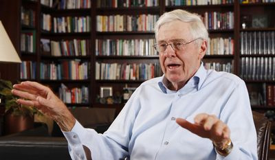 """FILE - In this photo May 22, 2012 file photo, Charles Koch speaks in his office at Koch Industries in Wichita, Kan. Koch, the billionaire industrialist, and his chief lieutenants offered a more delicate response this weekend when asked about President Donald Trump's plan to block immigration from seven Muslim-majority countries. They described Trump's plan as """"the wrong approach"""" that violated its dedication to """"free and open societies."""" (Bo Rader/The Wichita Eagle via AP, File)"""