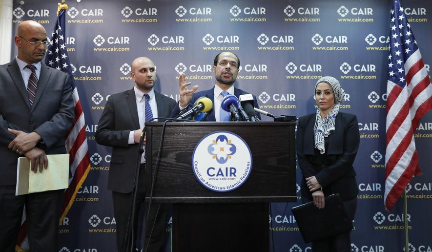 Attorneys Shereef Akeel, left, Gadeir Abbas, and Lena F. Masri, right, stand as Council on American-Islamic Relations (CAIR) national executive director Nihad Awad speaks during a news conference at the Council on American-Islamic Relations (CAIR), Monday, Jan. 30, 2017 in Washington. The group announced the filing of a federal lawsuit on behalf of more than 20 individuals challenging an executive order signed by President Donald Trump. (AP Photo/Alex Brandon)