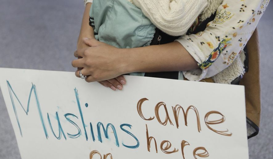 Amal Khan holds her one-year-old daughter Razan Sofia Bashir at San Francisco International Airport as she protests President Donald Trump's executive order that bars citizens of seven predominantly Muslim-majority countries from entering the U.S. Monday, Jan. 30, 2017, in San Francisco. (AP Photo/Marcio Jose Sanchez)