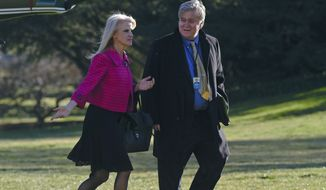In this Jan. 26, 2017, photo White House counselor Kellyanne Conway, left, and senior adviser Steve Bannon, right, walk on the South Lawn of the White House in Washington, after returning via Marine One from a trip to Philadelphia with President Donald Trump. Since taking office 10 days ago, President Donald Trump has moved to consolidate power within a small cadre of close aides at the White House. He's added a senior political adviser to the National Security Council and appears to have cut out Cabinet secretaries from decision making on some of his top policies, including the immigration and refugee order that led to protests, legal challenges and temporary detention of some legal U.S. residents this weekend. (AP Photo/Susan Walsh)