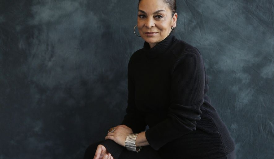 "This Jan. 19, 2017, photo shows actress Jasmine Guy in New York to promote her BET drama ""The Quad."" The series premieres Wednesday, Feb. 1. (AP Photo/Peter Morgan)"
