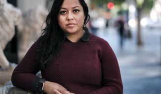 Mitzie Perez, a plaintiff in a lawsuit against Wells Fargo, poses for a photo in Los Angeles, Monday, Jan. 30, 2017. Perez applied for a student loan from Wells Fargo online to help cover the costs of her education at the University of California, Riverside. She had a Social Security number, license and passport, but was not able to proceed with the loan application after she disclosed she was not a U.S. citizen or permanent resident. The suit comes amid concern among immigrant groups that President Donald Trump will cancel Obama's Deferred Action for Childhood Arrivals program as part of a broader effort to control immigration. (AP Photo/Richard Vogel)