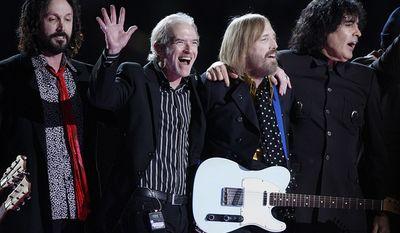 Tom Petty and the Heartbreakers - Super Bowl XLII (2008) Guitarist Michael Campbell, keyboard player Benmont Tench, Tom Petty and bassist Ron Blair after their performance during halftime of the Super Bowl XLII football game Sunday, Feb. 3, 2008, in Glendale, Ariz. (AP Photo/Julie Jacobson)