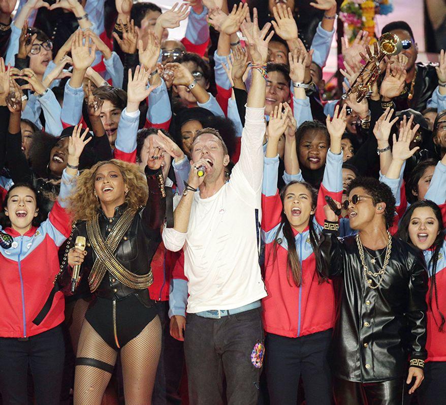 Colplay, Bruno Mars, Beyoncé, -Super Bowl 50 (2016) Beyoncé, Chris Martin, and Bruno Mars perform during halftime of the NFL Super Bowl 50 football game Sunday, Feb. 7, 2016, in Santa Clara, Calif. (AP Photo/Charlie Riedel)