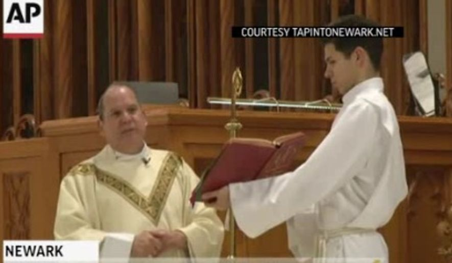 Essex County authorities say a 48-year-old Newark resident punched the Rev. Manuel Cruz in the mouth Saturday at Cathedral Basilica of the Sacred Heart in Newark. (Screen grab from TapintoNewark.net via AP video)
