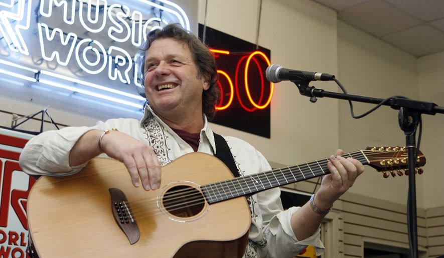 In this Thursday, April 17, 2008, file photo, John Wetton performs with the band Asia at a music store in New York. A statement from his publicist, Glass Onyon PR, says Wetton, 67, died Tuesday, Jan. 31, 2017, from colon cancer. (AP Photo/Jason DeCrow, file)