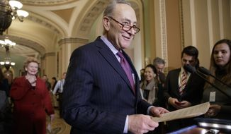 Senate Minority Leader Chuck Schumer, D-N.Y., followed by Sen. Debbie Stabenow, D-Mich., arrives for a news conference on Capitol Hill in Washington, Tuesday, Jan. 31, 2017. (AP Photo/J. Scott Applewhite) ** FILE **