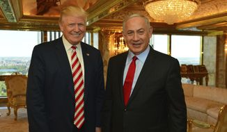In this handout photo made on Sunday, Sept. 25, 2016, provided by the Israeli Government Press Office, Republican Presidential candidate Donald Trump meets Israeli Prime Minister Benjamin Netanyahu in New York. (Kobi Gideon,GPO via AP) ** FILE **