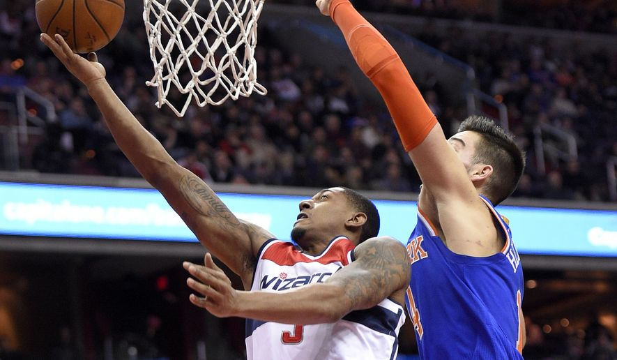Washington Wizards guard Bradley Beal (3) goes to the basket against New York Knicks center Willy Hernangomez, right, of Spain, during the second half of an NBA basketball game, Tuesday, Jan. 31, 2017, in Washington. The Wizards won 117-101. (AP Photo/Nick Wass)